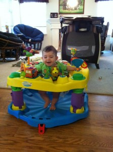 LP loves his exersaucer!