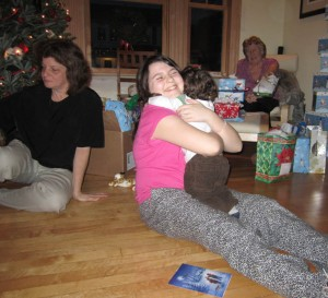 Hugging Cousin T, with Aunt B1 and Grandma J in the background