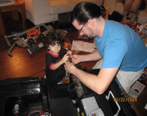 Damien and Daddy put together the Jeep